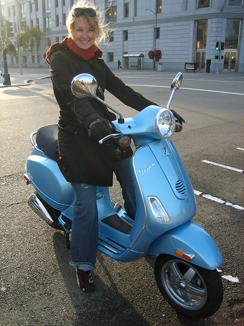 Steph windblown on the Vespa